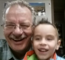 Grandpa and grandson. Two generations laughing together!